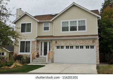 Family house with short driveway and landscaping