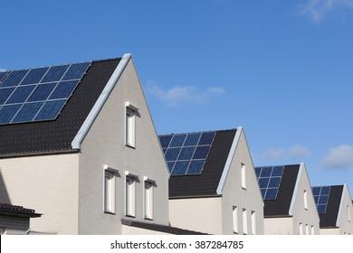 Family house with solar panels for alternative energy