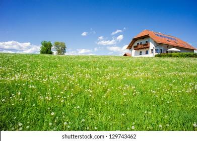 Family house in a summer landscape, taken in upper austria