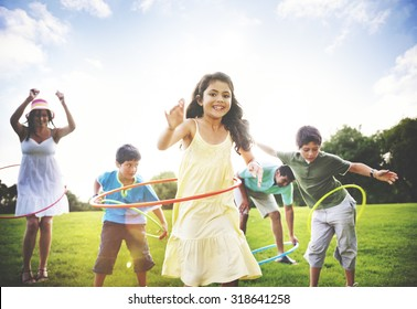 Family Hula Hooping Relaxing Outdoors Concept
