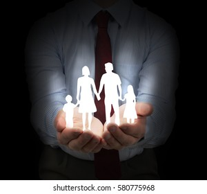 Family insurance and security concept with a dark background