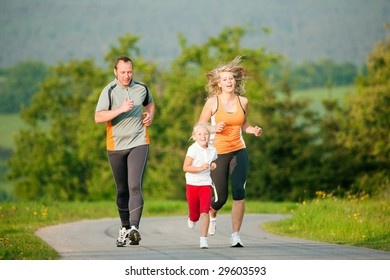 Family jogging outdoors with the kid