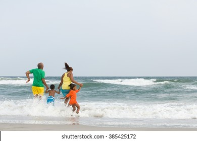 Family jumping in the sea