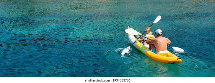 Family kayaking, father and son paddling in kayak on mediterranean sea canoe tour, having fun, outdoor activities with children in Greece - Shutterstock ID 1934333786