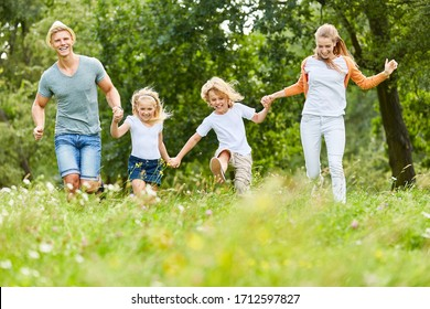 Family and kids have fun together in the garden in summer