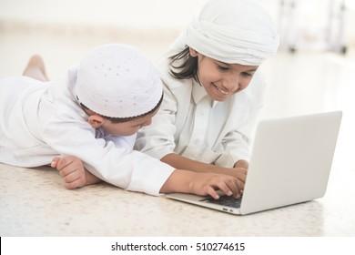 Family kids on laptop