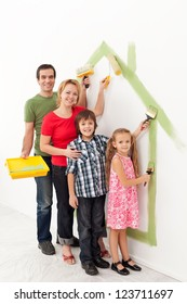 Family with kids painting together in their new home concept