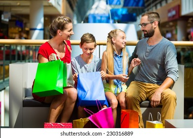 Family with kids shopping in mall having a break