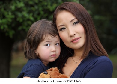Family Koreans. Mother and daughter. Mother with her baby in her arms. Mom and baby Asian appearance.