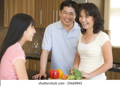 Family Laughing While Preparing meal,mealtime