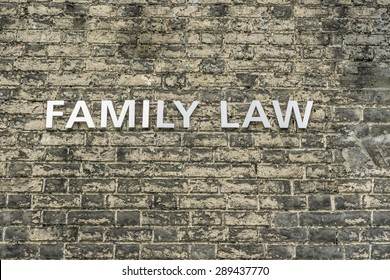 'Family Law' text on brick wall conceptual image