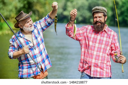 Family let you be who you are. summer weekend. mature men fisher. two fisherman with fishing rods. hobby and sport activity. Trout bait. father and son fishing. male friendship. family bonding.