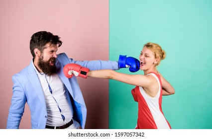 family life as everyday struggle. knockout punching. who is right. problems in relationship. sport. Strength and power. family couple boxing gloves. bearded man hipster fighting with woman.
