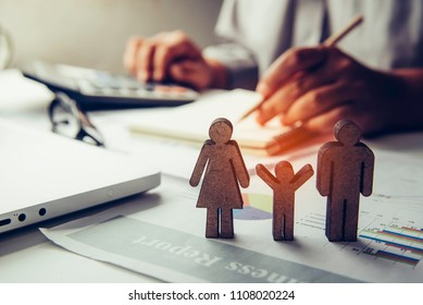 Family life icon and there are businessman working with laptop at background