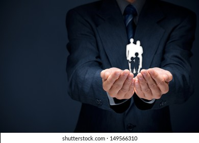 Family life insurance, family services, family policy and supporting families concepts. Businessman with protective gesture and silhouette representing young family.