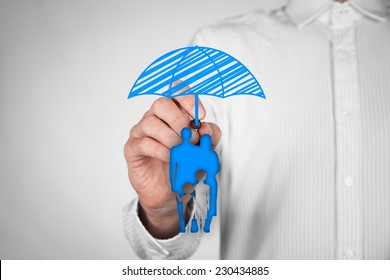 Family life insurance, family services and family policy concepts. Insurance agent draw umbrella (insurance symbol) above family icon.