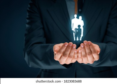 Family life insurance, family services and supporting families concepts. Businesswoman with protective gesture and silhouette representing young insured family.