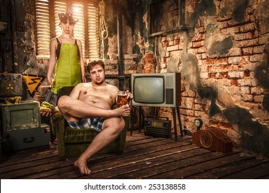 Family Life. Portrait of husband and wife in a poor slums room.