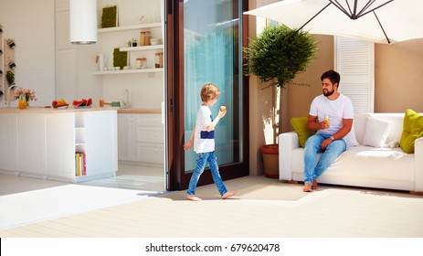 family lifestyle on summer patio, open space kitchen