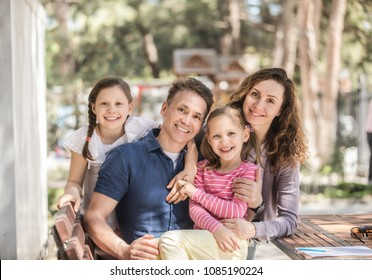 family lifestyle portrait of a mum and dad with their children having good time