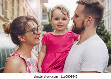 Family with little girl having fun together