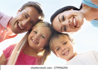 Family Looking Down Into Camera