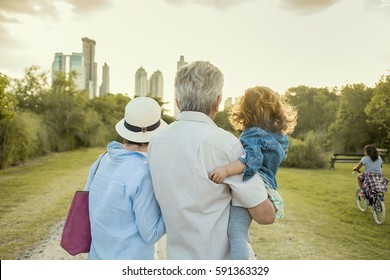 Family looking at the Skyline at the Park.
