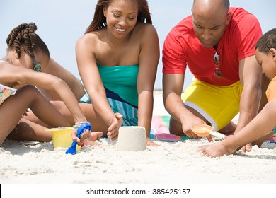 Family making sandcastles