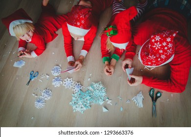 family making snowflakes from paper, Christmas crafts