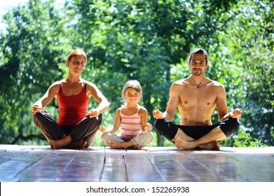 family meditation in yoga club