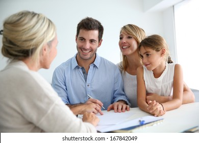 Family meeting real-estate agent for house investment