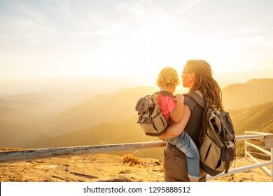 Family meets the sunset on the Moro rock in Sequoia national park, California, USA.