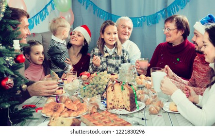 Family members making conversation during Christmas dinner