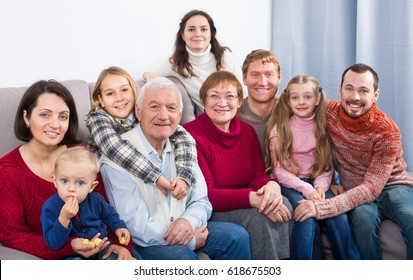 Family members making family photo during a reunion party