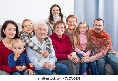 Family members making family photo during reunion party
