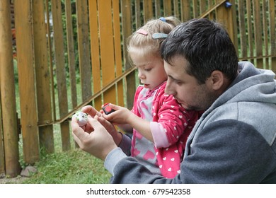 Family members playing together outdoors with fidget cube toy, stress relieving objects while not working
