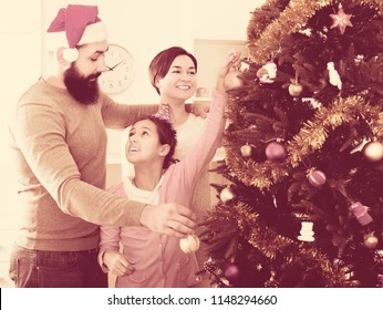 Family members preparing for Christmas together at home