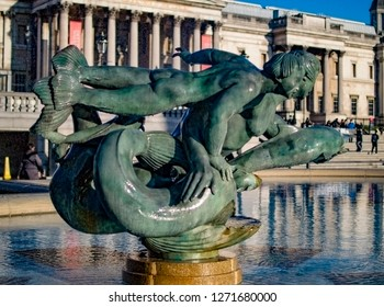 Family of mermaids and dolphin fountain at trafalgar square in london