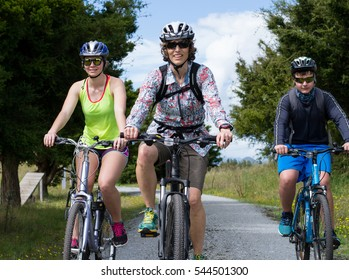 Family, Mom, Son, Daughter, mountain bike riding on a trail