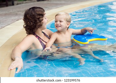 Family of mom and son enjoying their resort life lying in a swimming pool