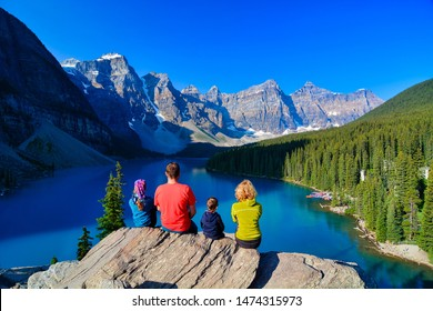 Family at the Moraine Lake, Rocky Mountains, Alberta Canada, 6th of August 2018.