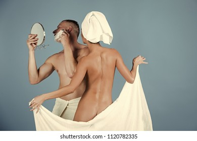 Family morning. bathing and taking shower. bathing of family couple, man trimming with razor.