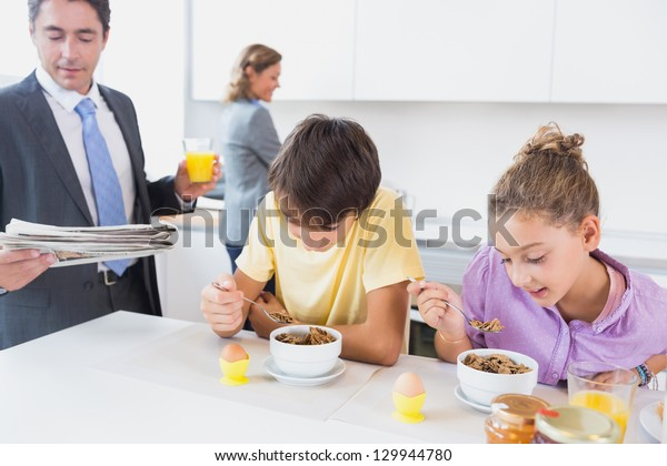 Family in the morning having breakfast