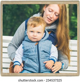 Family  mother with child in park walking in same clothes textile jeans jacket