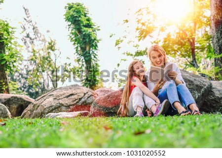 Family Mother And Child Read Book Relax In Weekend Holiday Lifestyle Park Outdoor Nature Background Or