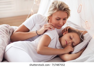 Family. Mother with daughter in a bed