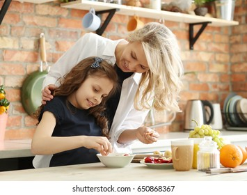 Family. Mother with daughter in kitchen