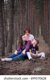 family mother and daughter and son rest in the forest