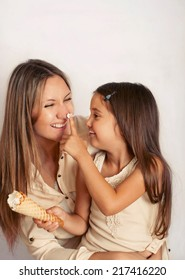 family of mother and doughter having fun with sweet cream puff, happy family concept