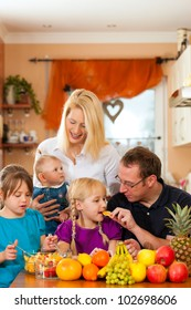 Family (mother, father and children) with lots of fruits, this is healthy nutrition for breakfast food